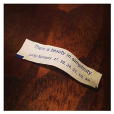 Fortune cookie message that reads: There is beauty in simplicity.